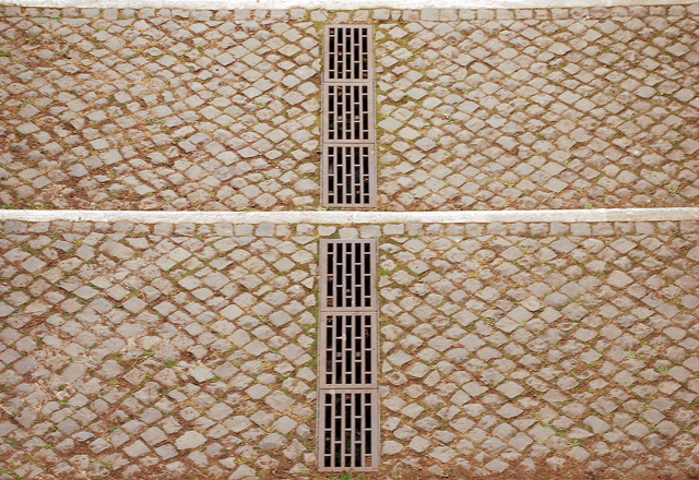 Ornate drain in cobbled paving The Roman Forum Lisa Cox