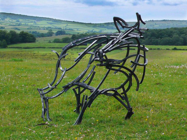 Startled wild board sculpture by Andrew Kay