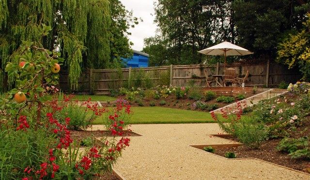 View from gravel pathway to decking Leatherhead Garden Design Lisa Cox