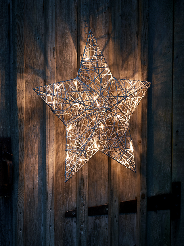 Faux rattan light up star by Cox & Cox