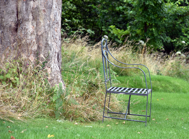 Lone chair under a tree Allt-y-bela Lisa Cox