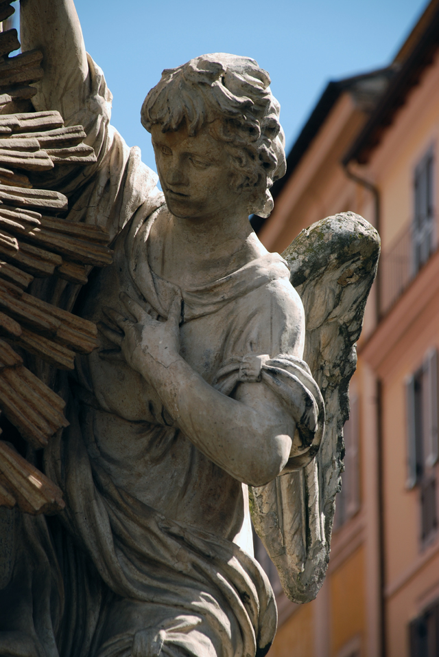 Angel on building in Roma by Lisa Cox