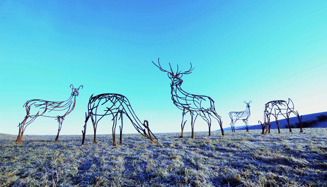 Herd of deer on moor by Andrew Kay sculpture
