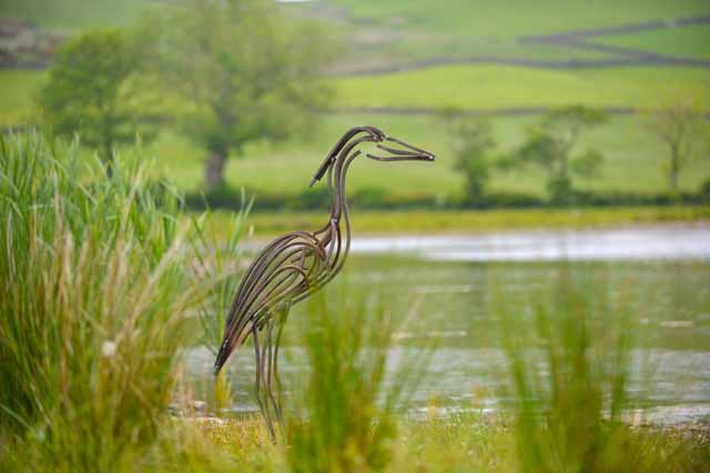 Heron by lake by Andrew Kay sculpture