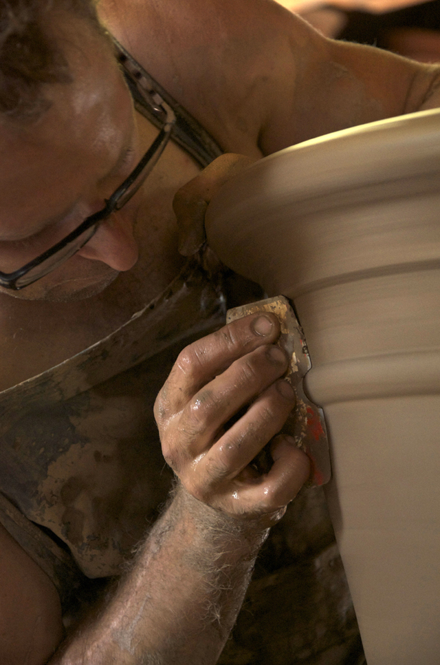 The finishing touches to handmade pots at Whichford Pottery