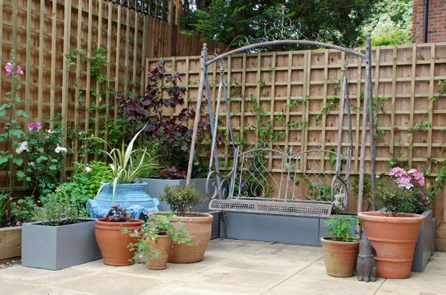 Bletchingley courtyard swing seat Lisa Cox Garden Designs