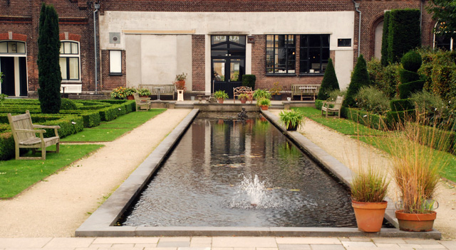 Formal long pond at Villa Augustus hotel Lisa Cox Garden Designs