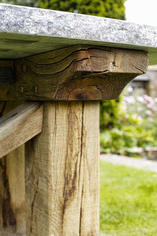 Oak table detail with stone top by Oxenwood outdoor furniture