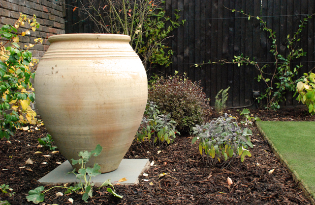 Greek urn in Chiswick garden Lisa Cox Designs